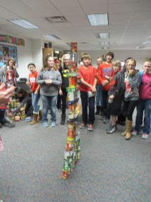 Creating sculptures out of cans in our Food Drive!