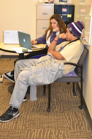 Working one-on-one with a student on his marketing proposal in the Writing Center!