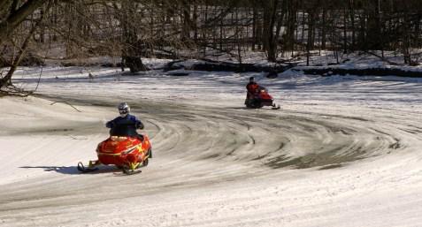 Snowmobiling on slushy Rum River