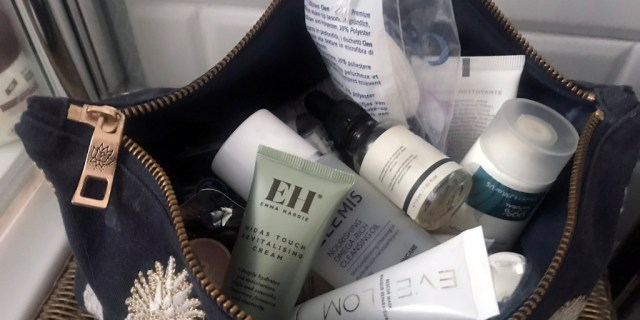Cosmetic bag bursting with samples