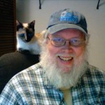 Photo of Don Taylor with cat Nasi.