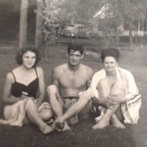 Photo of Bert Allen Roberts, Jr with two (unknown) women.