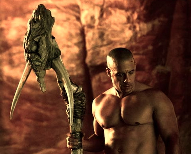 Riddick with alien staff