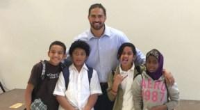 Dj Tialavea of the Atlanta Falcons speaking at West Jordan School 6