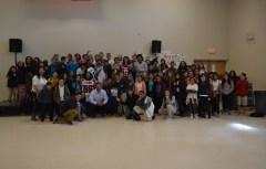 Dj Tialavea of the Atlanta Falcons speaking at West Jordan School 9