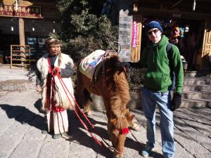 a lifestyle of travel in Shuhe Old Town ride a horse