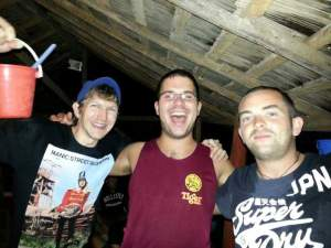 drinking buckets of booze in the bucket bar in Vang Vieng Laos