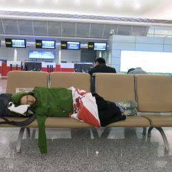 Jonny Blair sleeping in Hangzhou Airport