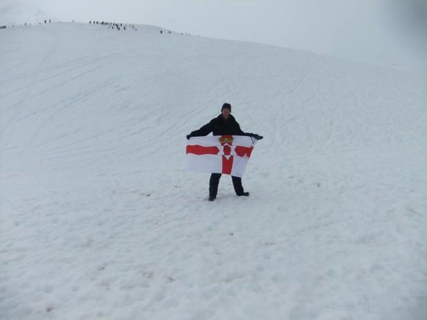 Jonny Blair flies the Northern Ireland flag on the Antarctic mainland