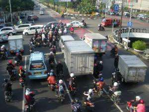 crossing the road in jakarta can be crazy traffic