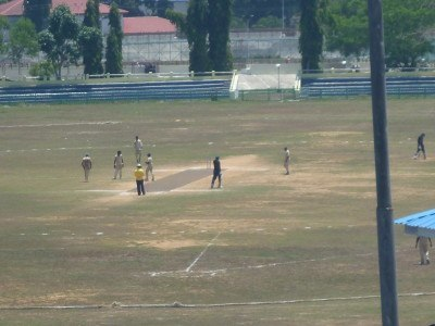 Watching cricket at Netaji Cricket Stadium
