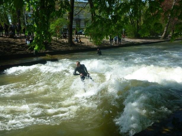 Locals surfing at the Eisbach