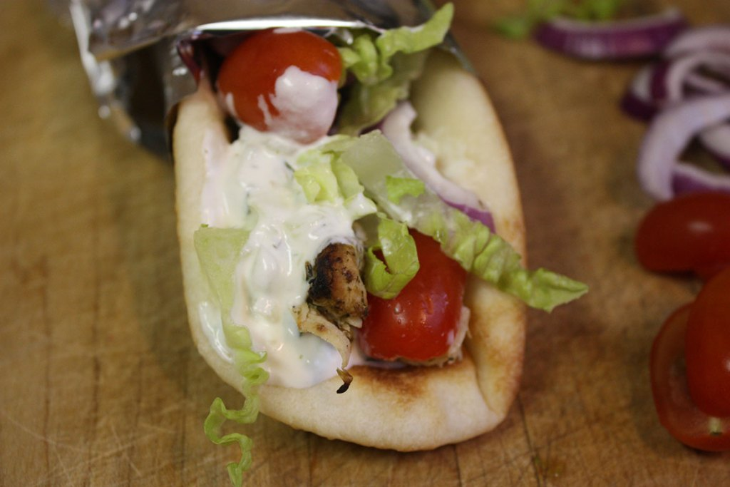 Chicken Gyros - Greek marinated chicken, stuffed in homemade naan, topped with fresh tzatziki sauce! So good!