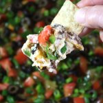 Black Bean Taco Dip - Warm, creamy dip topped with fresh tomatoes, cilantro, green olives, jalapenos, and green onions.