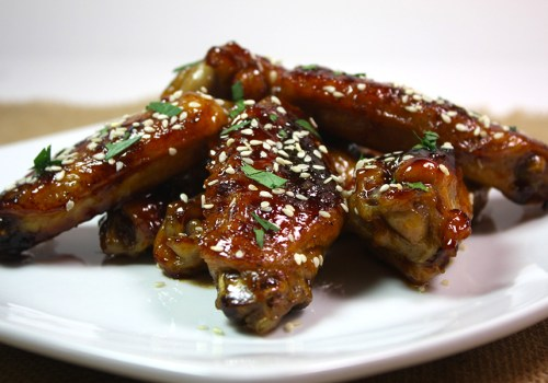 Honey Sriracha Wings - Crispy, sweet, and spicy baked chicken wings!