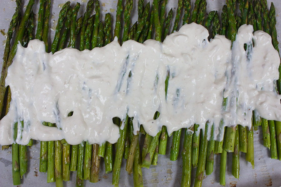 Horseradish Sour Cream Roasted Asparagus is a great side dish. It's an elegant side to serve with Easter dinner or any holiday meal.