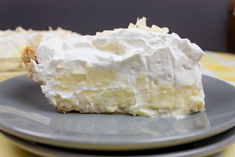 Coconut Cream Pie slice on gray plate