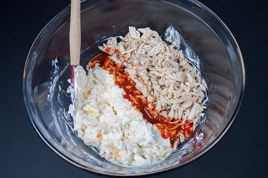 chicken buffalo sauce cream cheese in mixing bowl