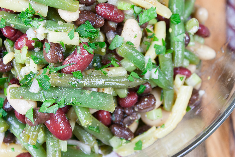 close up of Homemade Five Bean Salad in glass bowl