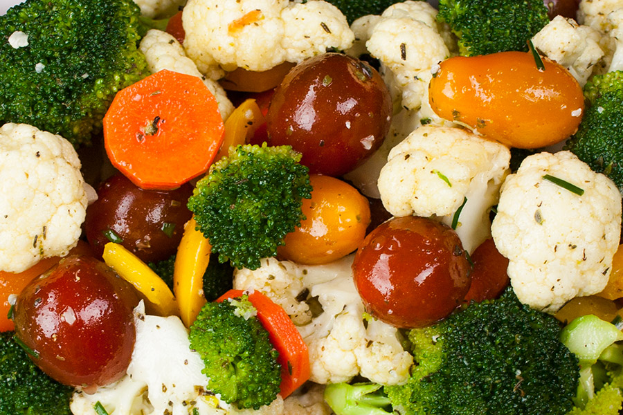Healthy Marinated Fresh Vegetable Salad - Quick and easy to make-ahead! Healthy, crunchy, fresh vegetables tossed in a vinaigrette make this salad recipe ideal for your 4th of July gathering.