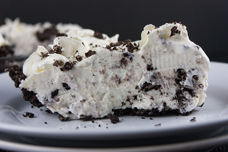 No Bake Cookies and Cream Pie - A delicious Oreo crust studded generously with everyone's favorite cookies and cream.