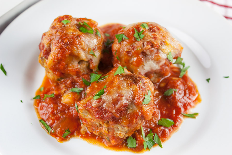 Easy Baked Parmesan Meatballs - One pan at it's best! Mouthwatering,tender, juicy, Italian meatballs smothered in goodness!