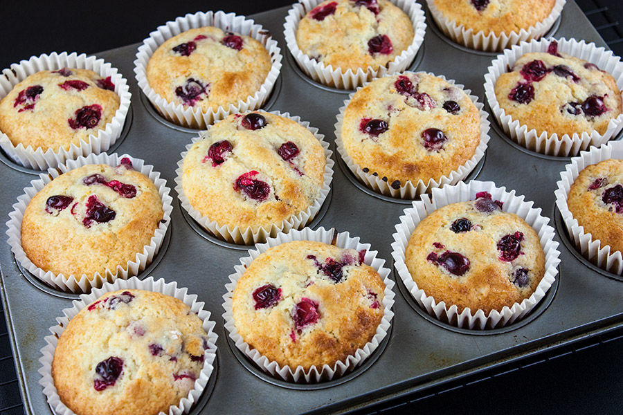 baked Cranberry Orange Muffins in a muffin tin