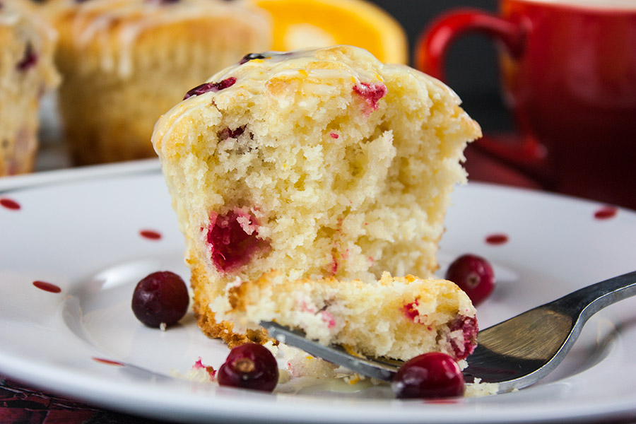 baked Cranberry Orange Muffin on white plate with fork
