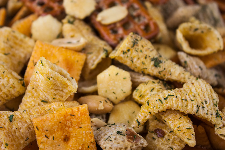party mix close up cheese crackers bugles oyster crackers covered in spices