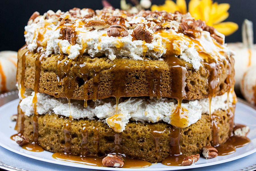 pumpkin cake topped with toasted pecans drizzled with the caramel topping