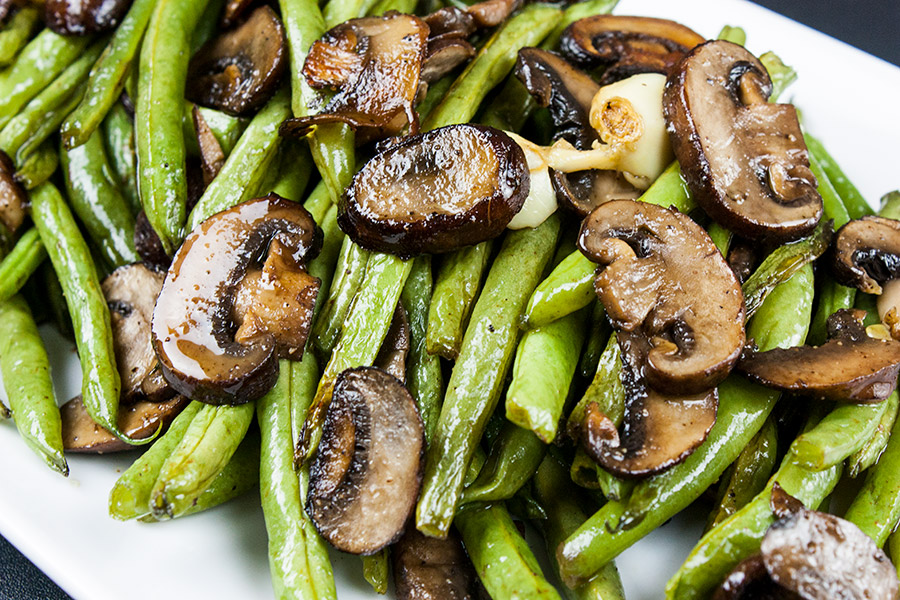 roasted green beans and mushrooms on white platter