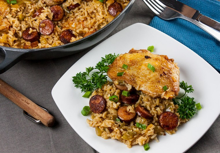 One Pot Chicken and Dirty Rice - Add a little Cajun spice to your dinner tonight! Spicy, creamy, delicious and ready in 30 minutes!