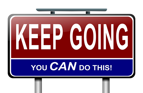 """Illustration of a sign saying """"Keep going, you CAN do this,"""" illustrating how vital it is for dyslexic children to learn how to have grit."""