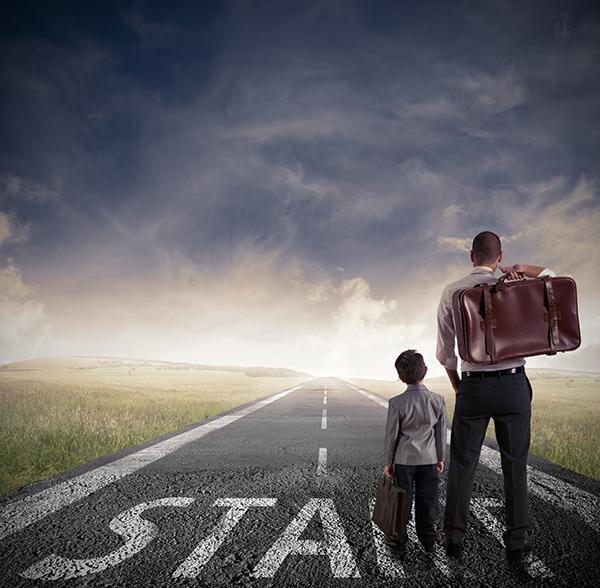 "A father and son carrying luggage head down a long road toward the horizon. At their feet is the word ""start."" Working with dyslexia is a long road, and it takes true perseverance to keep going."