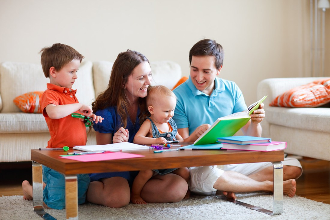 Reading aloud to children helps them increase their vocabulary and knowledge of the world and gives them an incredible advantage when they begin to learn to read. In this photo, a mother and father read with their two young children. Don M. Winn's new book Raising a Child with Dyslexia: What Every Parent Needs to Know discusses vital tools every parent can use with every child to help them become readers.