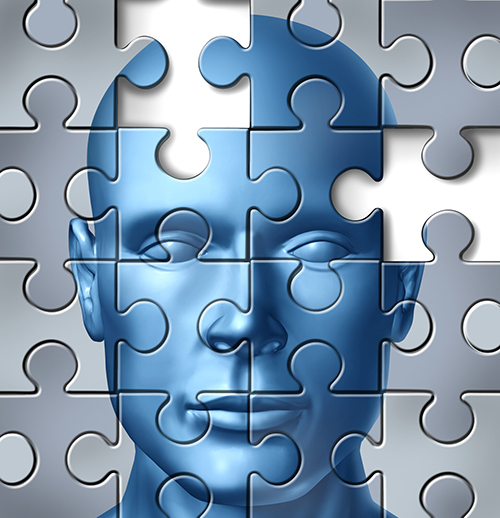 An graphic showing a blue human face against a gray background with the outlines of a jigsaw puzzle across the whole graphic. One puzzle piece is missing. The multiple deficit model of dyslexia means looking for potential multiple contributing factors to dyslexia.