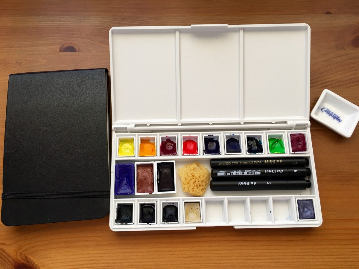 Grace art watercolor palette filled with new paints, brushes and a moleskine