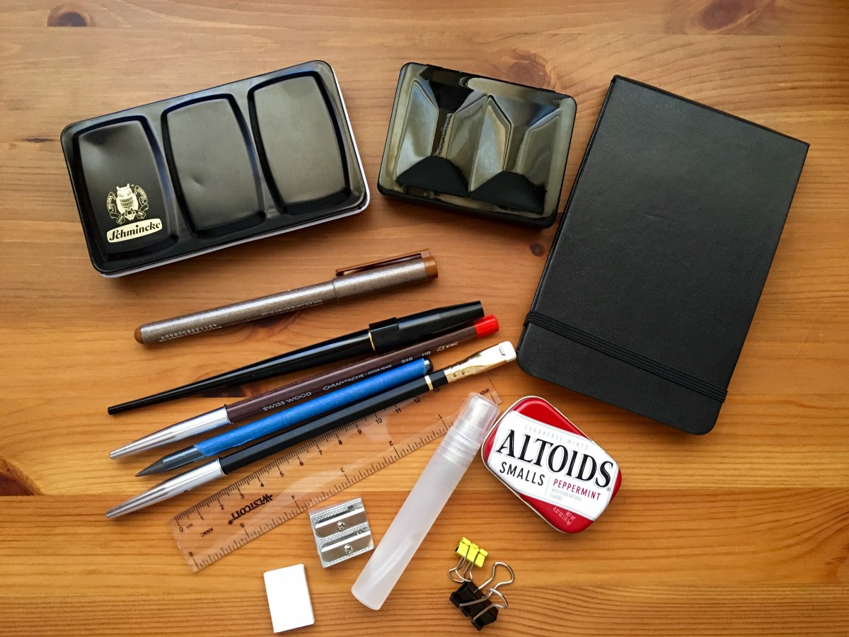 Watercolor travel tins set-up, Altoids, Whiskey Painters and Schmincke and a Moleskine Art Plus, Copic, pencils