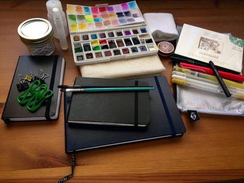 Travel carry, watercolor palette, Moleskine, Pertalic Aqua Journal, Leuttchurm 1917 sketch journal, Sennelier 4x6 block, paint brushes, GellyRoll pens, fountain pens, diaper, Nalgene, spray bottle, Alvin NB Mesh Bag