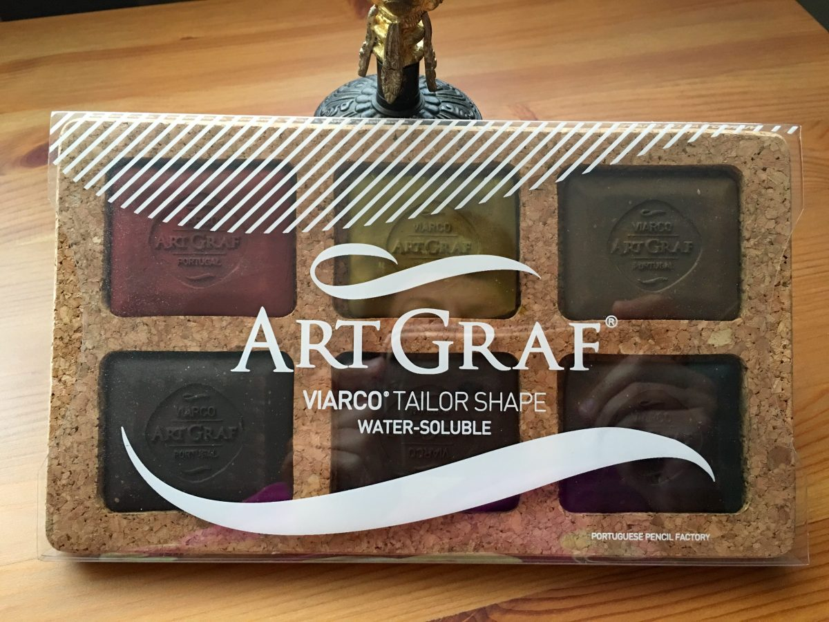 ArtGraf Tailor Chalks, which comes in six different colors- Sanguine, Ochre, Sepia, Brown, Dark Brown and Carbon Black. front of packaging