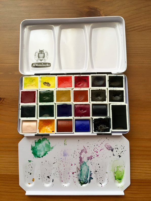 Schmincke and MaimeriBlu watercolor pans in a schmincke metal travel palette