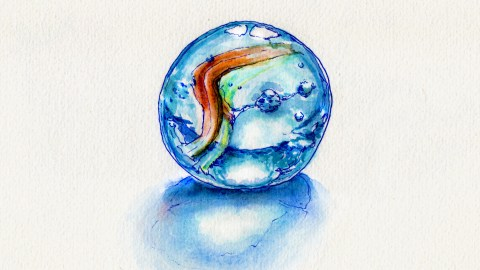 Day 2 - My Favorite Childhood Toy a blue and orange glass marble