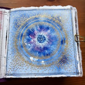 Blue Star Mandala by Jessica Seacrest using Finetec watercolors, gelly roll pen, daniel smith watercolors