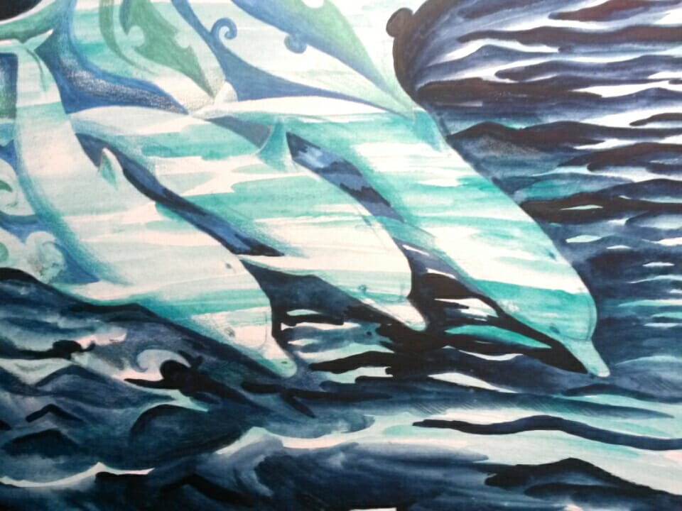 Dolphins swimming through bioluminescent water- an attempt to capture the joy of night watch in the