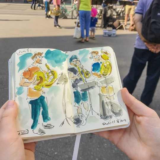 Sketched a few street musicians and some commuters on Tuesday. I colored the commuter sketch at home