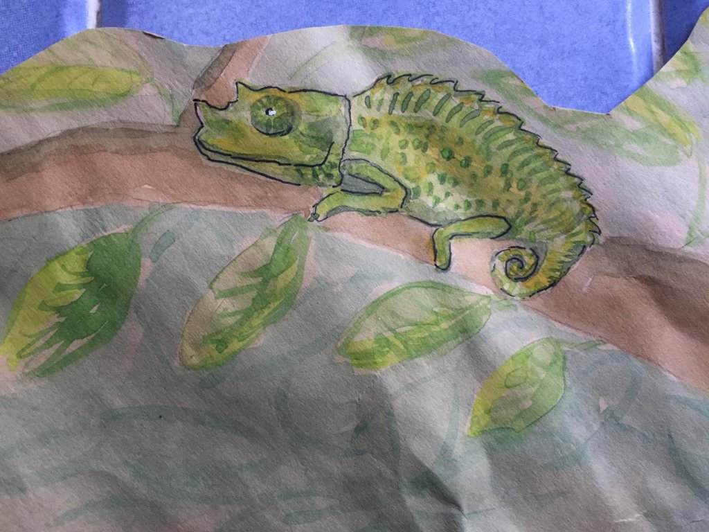 Day 11 -chameleon. I saw a baby chameleon in a forest. I made this into a design on some wrapping pa