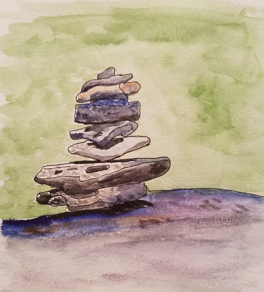 In the mountains of New Hampshire you will see stacked stones which make the trails above the tree l