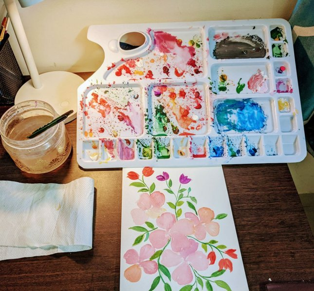 Watercolor flowers and painting palette