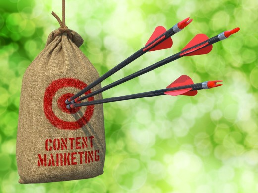 Content Marketing - Three Arrows Hit in Red Target on a Hanging Sack on Natural Bokeh Background.