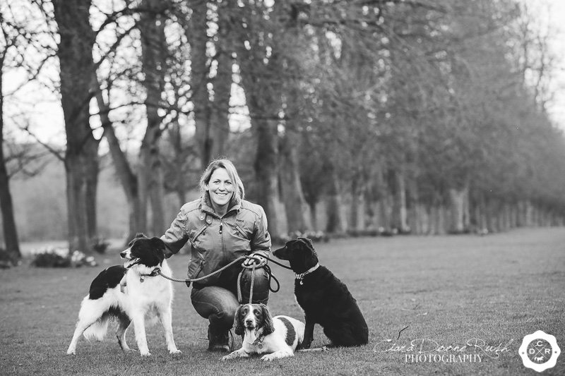 black and white photo of a an owner and her dogs
